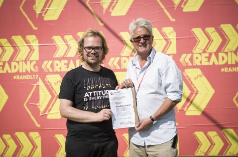 Our Festival Project Manager Paul Hawkins awarding Festival Republic MD Melvin Benn the gold award certificate